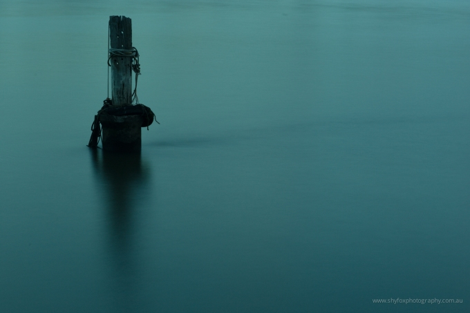 Long exposure photography of a pylon in the Brisbane River.